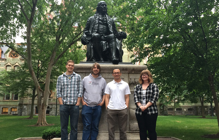From left: C. R. Walters, D. M. Szantai-Kis, Prof. E. J. Petersson, T. M. Barrett (E. M. Hoang not pictured) (University of Pennsylvania, USA); a statue of the University of Pennsylvania's founder, Benjamin Franklin, is seen in the background